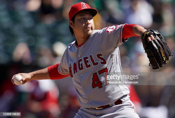 Junichi Tazawa of the Los Angeles Angels of Anaheim pitches against the Oakland Athletics in the bottom of the fourth inning at Oakland Alameda...