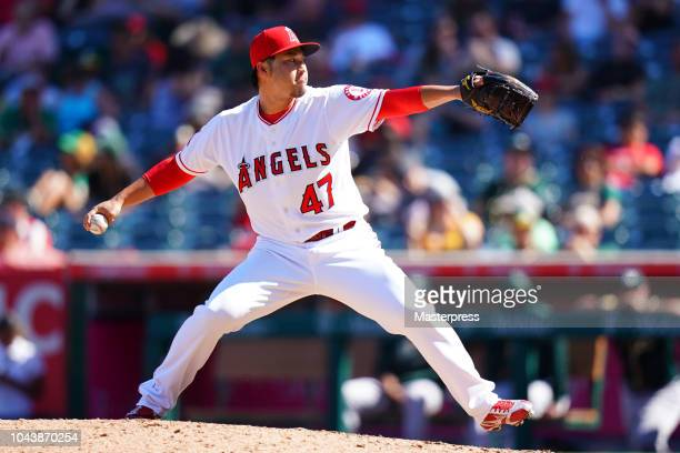 Junichi Tazawa of the Los Angeles Angels of Anaheim pitches during the game against the Oakland Athletics at Angel Stadium on September 30 2018 in...