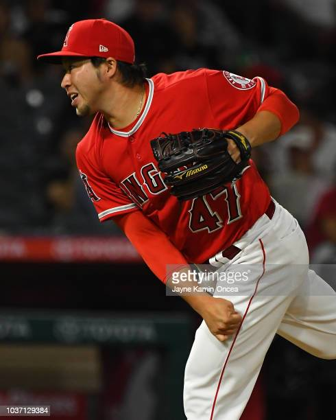 Junichi Tazawa of the Los Angeles Angels of Anaheim pitches in the fifth inning of the game against the Seattle Mariners at Angel Stadium on...