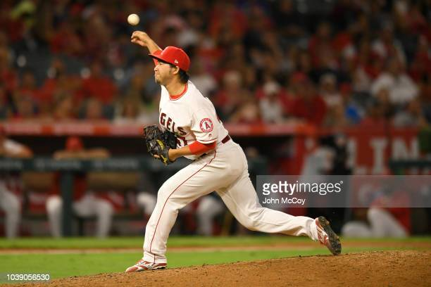 Junichi Tazawa of the Los Angeles Angels of Anaheim pitches in the ninth inning aginast the Seattle Mariners at Angel Stadium on September 15 2018 in...