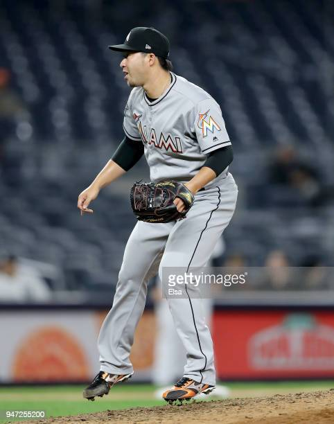 Junichi Tazawa of the Miami Marlins delivers a pitch in the eighth inning against the New York Yankees at Yankee Stadium on April 16 2018 in the...