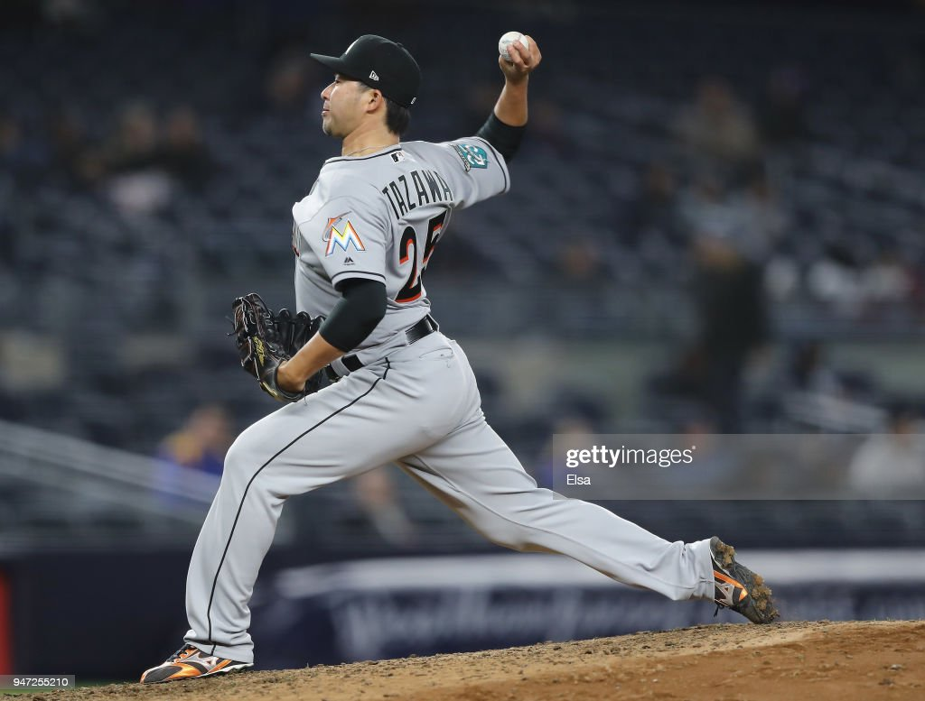 Junichi Tazawa #25 of the Miami Marlins delivers a pitch in the eighth inning against the New York Yankees at Yankee Stadium on April 16, 2018 in the Bronx borough of New York City.