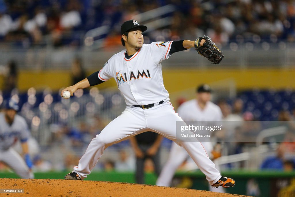 Junichi Tazawa #25 of the Miami Marlins delivers a pitch in the fourth inning against the Los Angeles Dodgers at Marlins Park on May 17, 2018 in Miami, Florida.