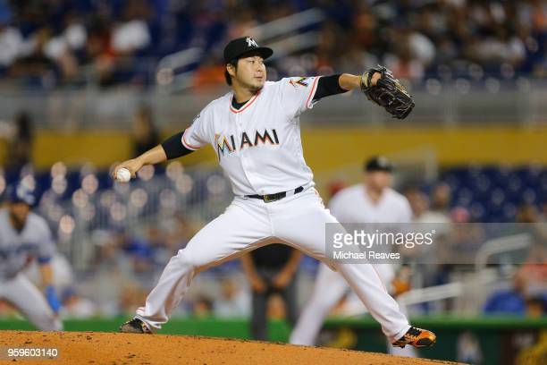 Junichi Tazawa of the Miami Marlins delivers a pitch in the fourth inning against the Los Angeles Dodgers at Marlins Park on May 17 2018 in Miami...