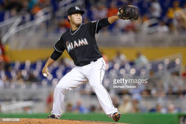 Junichi Tazawa of the Miami Marlins delivers a pitch in the ninth inning against the Pittsburgh Pirates at Marlins Park on April 13 2018 in Miami...