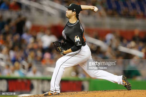 Junichi Tazawa of the Miami Marlins delivers a pitch in the seventh inning against the Atlanta Braves at Marlins Park on May 11 2018 in Miami Florida