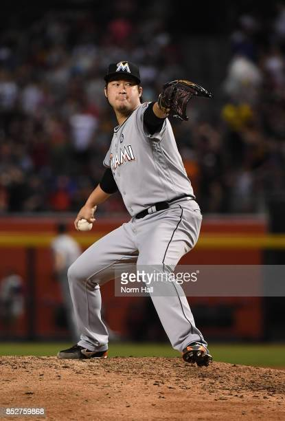 Junichi Tazawa of the Miami Marlins delivers a warm up pitch against the Arizona Diamondbacks at Chase Field on September 22 2017 in Phoenix Arizona