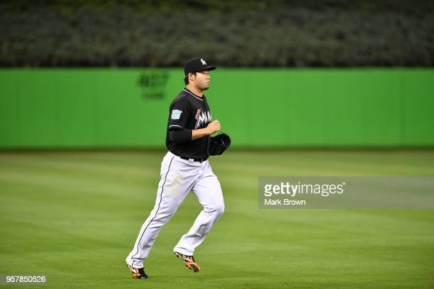 Junichi Tazawa of the Miami Marlins enters the game in the eighth inning against the Atlanta Braves at Marlins Park on May 12 2018 in Miami Florida