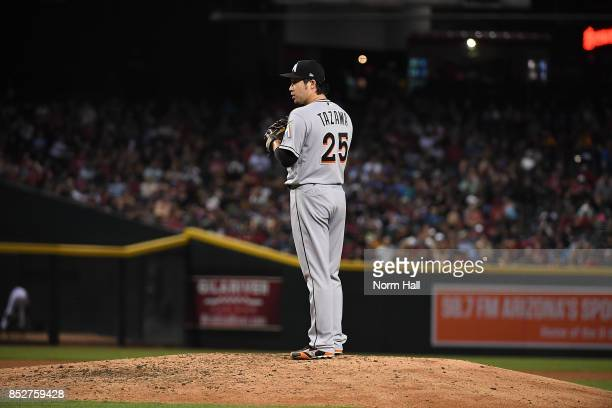 Junichi Tazawa of the Miami Marlins gets ready to deliver a pitch against the Arizona Diamondbacks at Chase Field on September 22 2017 in Phoenix...