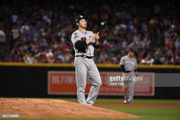 Junichi Tazawa of the Miami Marlins gets ready to pitch against the Arizona Diamondbacks at Chase Field on September 22 2017 in Phoenix Arizona