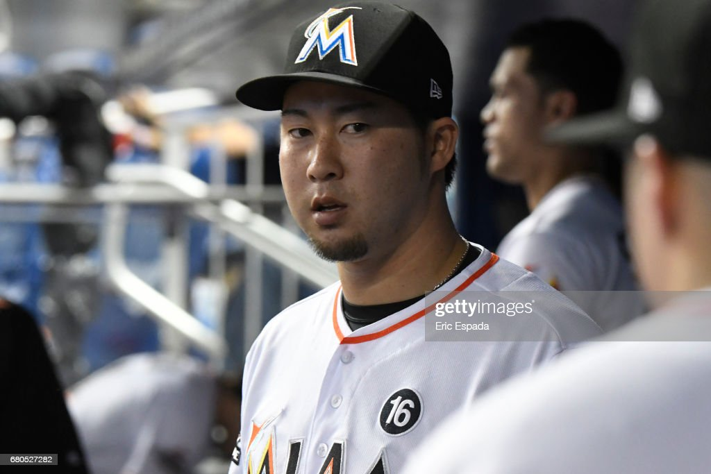 Junichi Tazawa #25 of the Miami Marlins in the dugout after pitching the eighth inning against the St. Louis Cardinals at Marlins Park on May 8, 2017 in Miami, Florida.