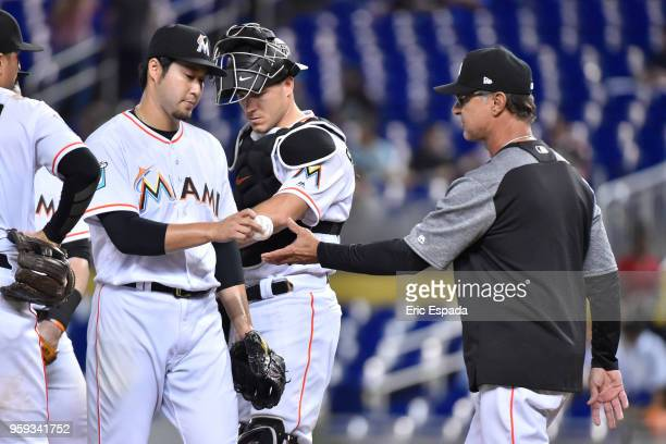 Junichi Tazawa of the Miami Marlins is pulled by Manager Don Mattingly during the sixth inning against the Los Angeles Dodgers at Marlins Park on May...