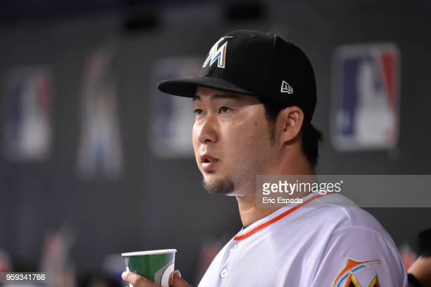 Junichi Tazawa of the Miami Marlins looks on after being pulled in the sixth inning against the Los Angeles Dodgers at Marlins Park on May 16 2018 in...