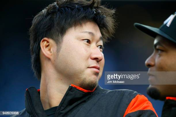 Junichi Tazawa of the Miami Marlins looks on before a game against the New York Yankees at Yankee Stadium on April 17 2018 in the Bronx borough of...
