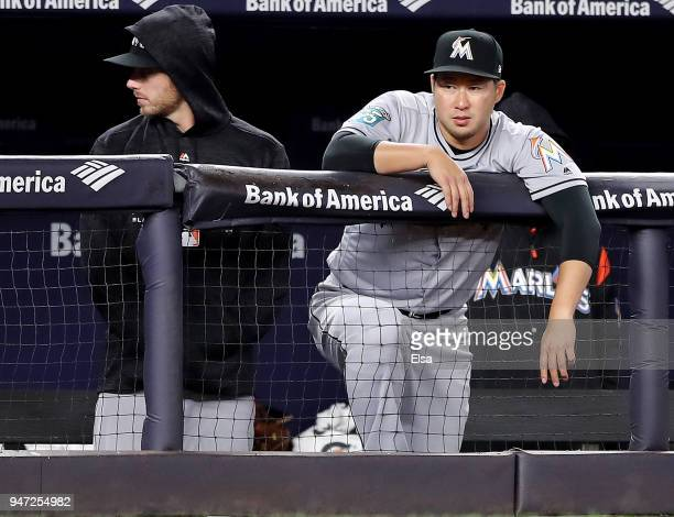 Junichi Tazawa of the Miami Marlins looks on from the bench in the ninth inning against the New York Yankees at Yankee Stadium on April 16 2018 in...