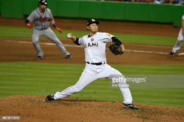 Junichi Tazawa of the Miami Marlins pitches during the 8th inning against the Atlanta Braves at Marlins Park on April 12 2017 in Miami Florida
