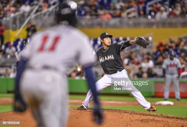 Junichi Tazawa of the Miami Marlins pitches in the eighth inning against the Atlanta Braves at Marlins Park on May 12 2018 in Miami Florida