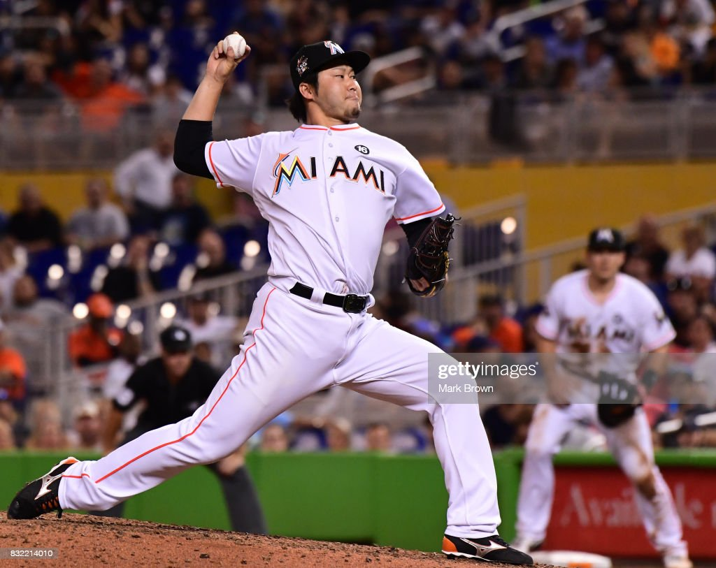 Junichi Tazawa #25 of the Miami Marlins pitches in the seventh inning during the game between the Miami Marlins and the San Francisco Giants at Marlins Park on August 15, 2017 in Miami, Florida.