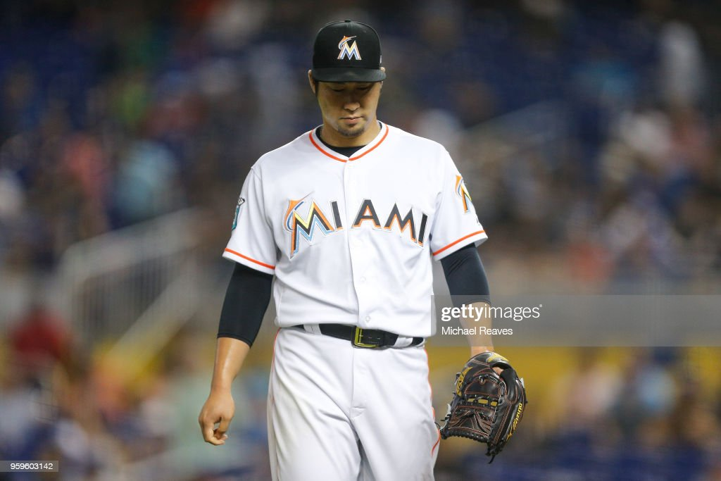 Junichi Tazawa #25 of the Miami Marlins reacts after the fourth inning against the Los Angeles Dodgers at Marlins Park on May 17, 2018 in Miami, Florida.