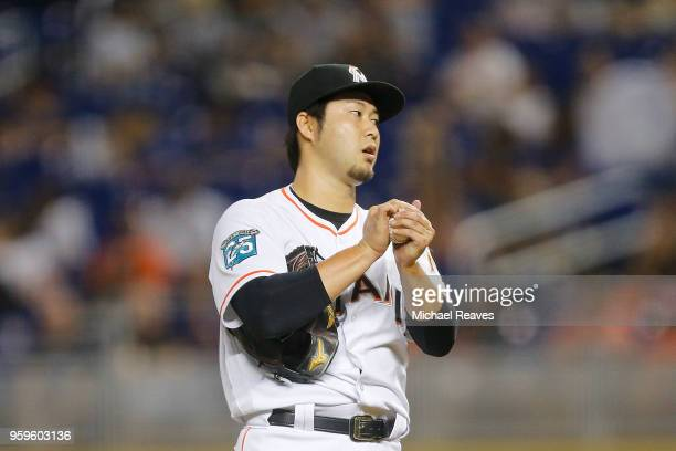 Junichi Tazawa of the Miami Marlins reacts in the fourth inning against the Los Angeles Dodgers at Marlins Park on May 17 2018 in Miami Florida