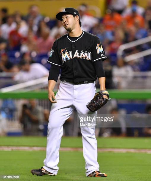 Junichi Tazawa of the Miami Marlins reacts to a call of one of his pitches in the eighth inning against the Atlanta Braves at Marlins Park on May 12...