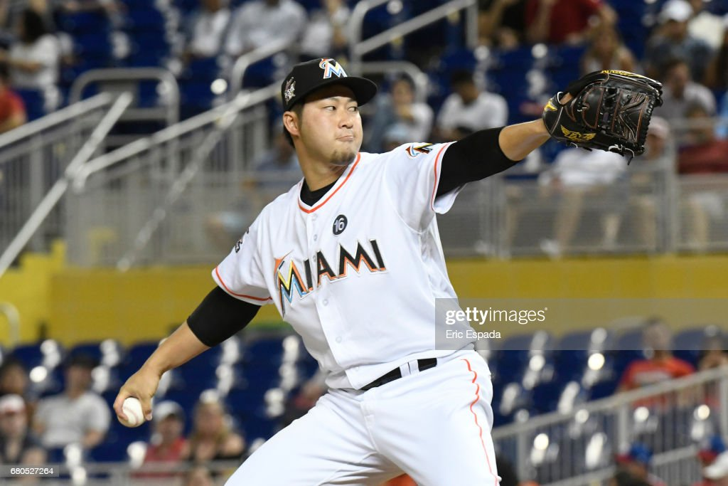 Junichi Tazawa #25 of the Miami Marlins throws a pitch during the eighth inning against the St. Louis Cardinals at Marlins Park on May 8, 2017 in Miami, Florida.