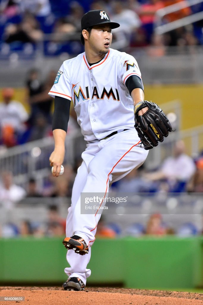 Junichi Tazawa #25 of the Miami Marlins throws a pitch during the eighth inning against the Philadelphia Phillies at Marlins Park on May 2, 2018 in Miami, Florida.