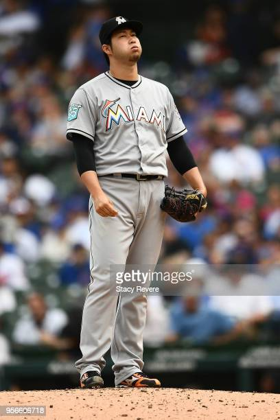 Junichi Tazawa of the Miami Marlins throws a pitch during the fourth inning of a game against the Chicago Cubs at Wrigley Field on May 9 2018 in...