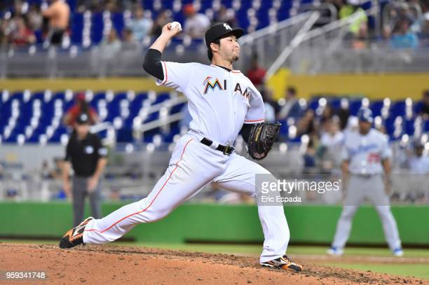 Junichi Tazawa of the Miami Marlins throws a pitch during the sixth inning against the Los Angeles Dodgers at Marlins Park on May 16 2018 in Miami...
