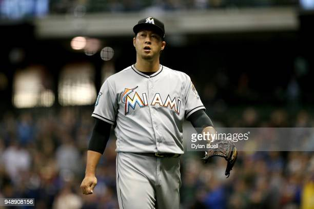 Junichi Tazawa of the Miami Marlins walks off the mound after the sixth inning against the Milwaukee Brewers at Miller Park on April 19 2018 in...