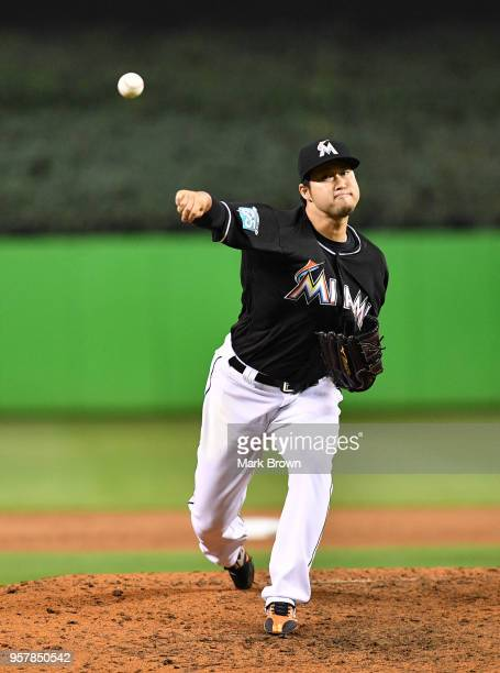 Junichi Tazawa of the Miami Marlins warms up in the eighth inning against the Atlanta Braves at Marlins Park on May 12 2018 in Miami Florida