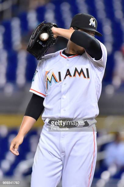 Junichi Tazawa of the Miami Marlins wipes his forehead during the sixth inning against the Los Angeles Dodgers at Marlins Park on May 16 2018 in...