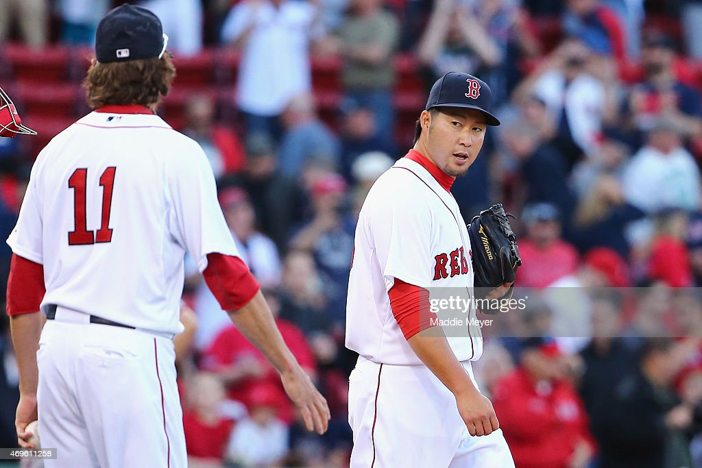 Junichi Tazawa #36 talks with Clay Buchholz #11 of the Boston Red Sox at the end of the ninth inning at Fenway Park on April 13, 2015 in Boston, Massachusetts. The Red Sox defeat the Nationals 9-4.