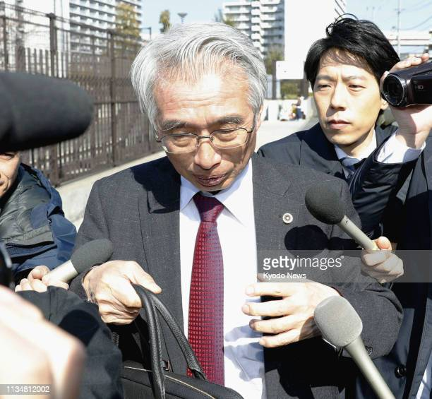Junichiro Hironaka a lawyer for former Nissan Motor Co Chairman Carlos Ghosn is surrounded by the press in Tokyo on April 4 after his client was...