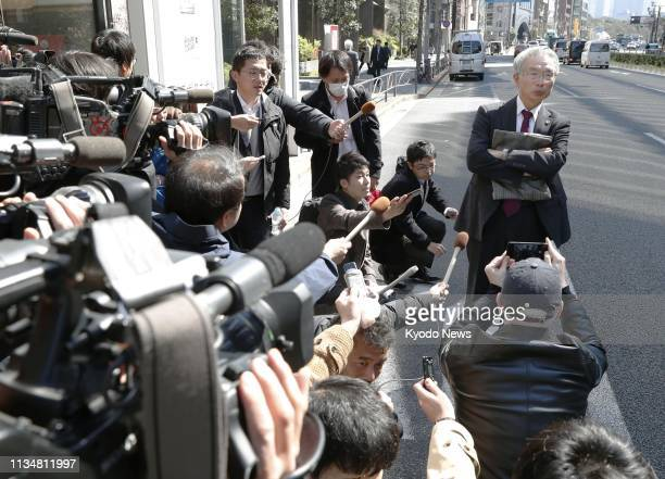Junichiro Hironaka a lawyer for former Nissan Motor Co Chairman Carlos Ghosn meets the press in Tokyo on April 4 after his client was served with a...