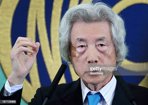 Junichiro Koizumi, former Japan prime minister, gestures as he speaks during a news conference at the Japan National Press Club in Tokyo, Japan, on...