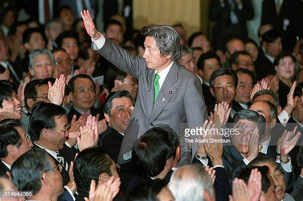 Junichiro Koizumi waves to fellow lawmakers after elected as new the Liberal Democratic Party president at LDP headquarters on April 24 2001 in Tokyo...