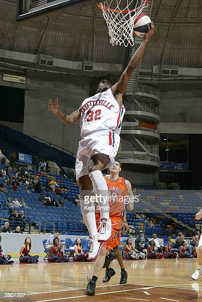 Junie Sanders of the Fayetteville Patriots attempts a dunk against the Columbus Riverdragons December 12, 2003 at the Crown Coliseum in Fayetteville,...
