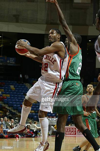 Junie Sanders of the Fayetteville Patriots drives to the basket against Karim Shabazz of the Charleston Lowgators at the Crown Coliseum November 29...