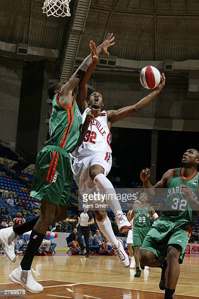 Junie Sanders of the Fayetteville Patriots makes the layup in traffic against Karim Shabazz of the Charleston Lowgators at the Crown Coliseum...