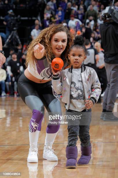 Junie Shumpert daughter of Iman Shumpert of the Sacramento Kings holds onto a mini basketball during the game between the Portland Trail Blazers and...