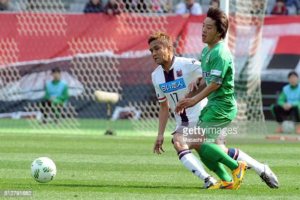 Juniichi Inamoto of Hokkaido Consadole Sapporo and Yoshiaki Takagi of Tokyo Verdy compete for the ball in during the JLeague second division match...