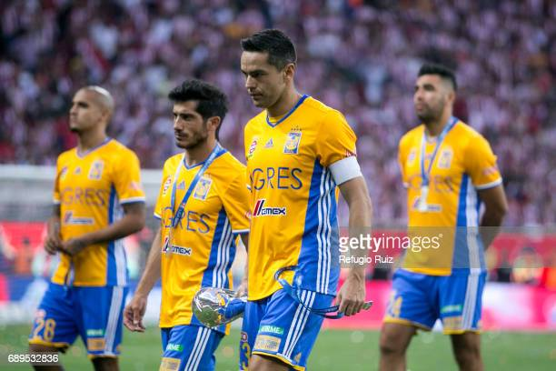 Juninho and Damián Alvarez of Tigres look dejected after losing the Final second leg match between Chivas and Tigres UANL as part of the Torneo...