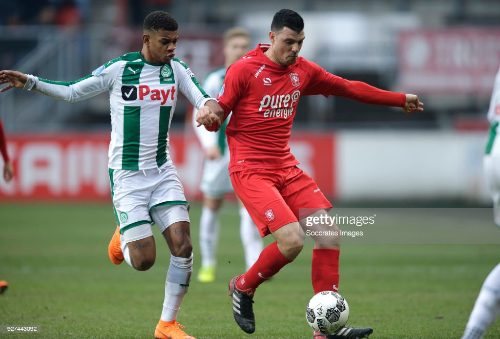 Juninho Bacuna of FC Groningen , Haris Vuckic of FC Twente during the Dutch Eredivisie match between Fc Twente v FC Groningen at the De Grolsch Veste on March 4, 2018 in Enschede Netherlands