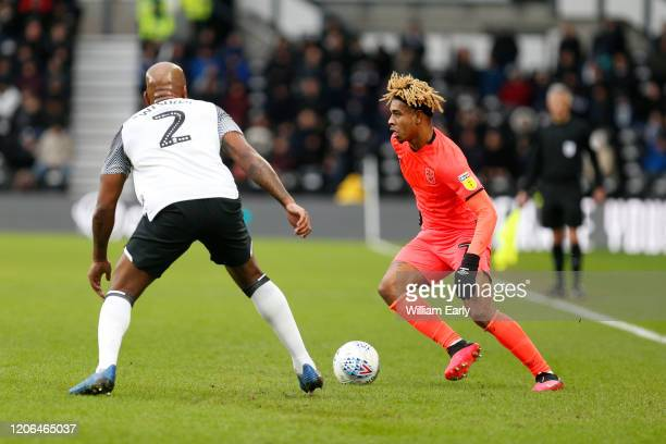 Juninho Bacuna of Huddersfield Town and Andre Wisdom of Derby County during the Sky Bet Championship match between Derby County and Huddersfield Town...