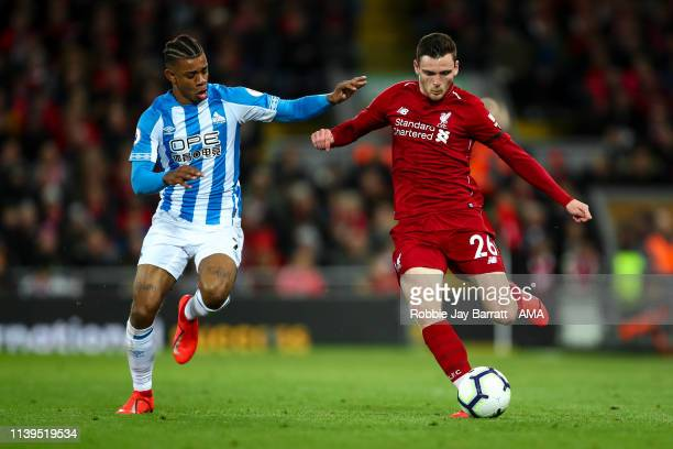 Juninho Bacuna of Huddersfield Town and Andrew Robertson of Liverpool during the Premier League match between Liverpool FC and Huddersfield Town at...