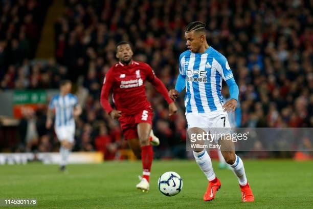 Juninho Bacuna of Huddersfield Town and Georginio Wijnaldum of Liverpool during the Premier League match between Liverpool FC and Huddersfield Town...