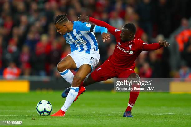 Juninho Bacuna of Huddersfield Town and Naby Keita of Liverpool during the Premier League match between Liverpool FC and Huddersfield Town at Anfield...