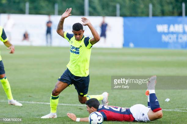 Juninho Bacuna of Huddersfield Town fouls Riccardo Orsolini during the preseason friendly between Huddersfield Town and FC Bologna 1909 on July 31...