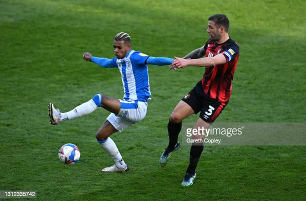 Juninho Bacuna of Huddersfield Town is challenged by Steve Cook of Bournemouth during the Sky Bet Championship match between Huddersfield Town and...